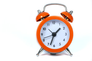 orange alarm clock isolated on white background